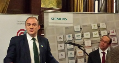 Ed Davey, energy secretary with Dr Tim Rotheray looking on, during a speech at ADE report in Westminster